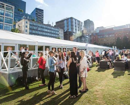 corporate guest enjoy drinks on the lawn at the hac artillery garden for a summer party